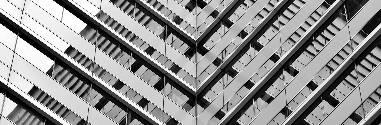 Perspective view of skyscrapper windows for governance software solutions and cyber security systems & risk and compliance solutions by Strata Security Solutions